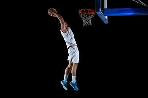 Bureaubladachtergronden Basketbal Een man Zwarte achtergrond Springend Hand Een bal Uniform atletisch