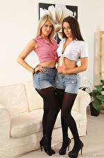 Picture Lola A Jayne M Couch 2 Blonde girl Brown haired Shorts Skirt Legs Stilettos Pantyhose young woman