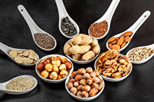 Pictures Nuts Walnut Hazelnut Sunflower seed Gray background Spoon Grain Food