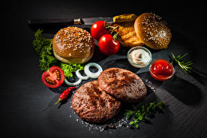 Fotos Fast food Burger Brötchen Frikadelle Tomaten Ketchup Salz
