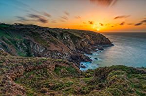 Bilder Frankreich Morgendämmerung und Sonnenuntergang Küste Felsen Laubmoose Sonne Brittany Natur