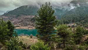 Hintergrundbilder Griechenland See Gebirge Wälder Nebel Bäume Tsivlou lake Natur