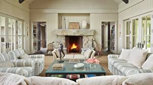 Pictures Interior Room Lounge sitting room Design Fireplace Wing chair Couch Pillows Table