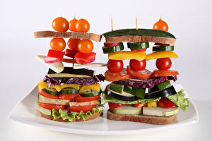 Pictures Creative Butterbrot Bread Tomatoes Vegetables Gray background Food
