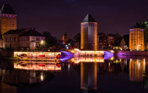 Picture France Strasbourg Building River Bridge Night time Street lights Cities