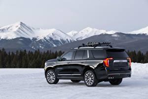 Bilder GMC Berg Schwarz Metallisch Seitlich Sport Utility Vehicle Schnee Yukon Denali, 2020 Autos