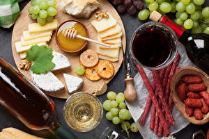 Images Honey Cheese Wine Grapes Sausage Cutting board Sliced food Bottle Food