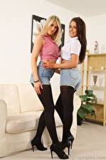 Images Lola A Jayne M Sofa 2 Blonde girl Brown haired Smile Shorts Skirt Legs High heels Pantyhose young woman