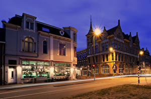 Images Netherlands Building Night time Street Street lights Haarlem