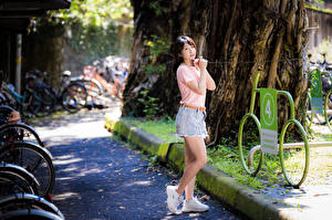 Pictures Asian Pose Legs T-shirt Hands Staring young woman