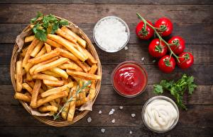 Images French fries Tomatoes Bowl Cutting board Ketchup Food