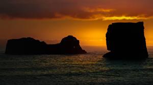 Fotos Island Meer Morgendämmerung und Sonnenuntergang Felsen Dyrholaey