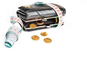 Bakgrundsbilder på skrivbordet Pengar Ett mynt Vit bakgrund Plånbok Måttband