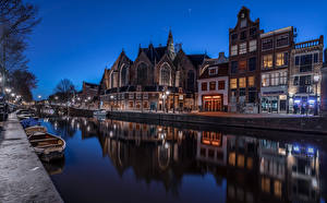 Pictures Netherlands Amsterdam Houses Boats Canal Night time Cities