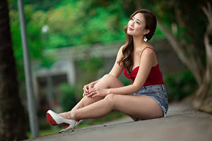 Images Asian Sit High heels Legs Shorts Sleeveless shirt Smile Blurred background Brown haired Girls