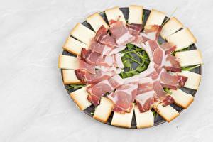 Photo Cheese Ham Gray background Sliced food