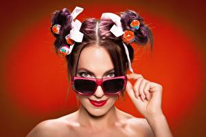 Wallpapers Glasses Hairdo Brown haired Red background Glance Chupa Chups young woman