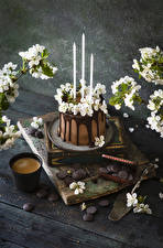 Pictures Coffee Cappuccino Cakes Candles Chocolate Flowering trees Boards Highball glass Branches Flowers