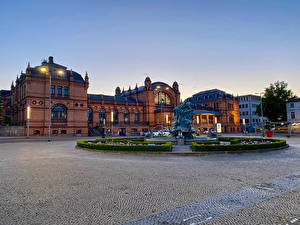 Pictures Germany Building Fountains Evening Sculptures Town square Street lights Schwerin Cities