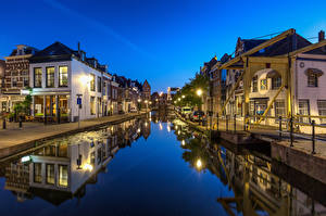 Picture Netherlands Evening Houses Canal Street lights Maassluis Cities