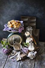 Bilder Stillleben Flieder Backware Milch Bretter Ast Flaschen Löffel Blumen