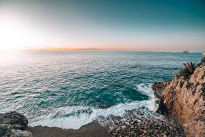 Bilder Sonnenaufgänge und Sonnenuntergänge Küste Meer Monaco Felsen Horizont Natur