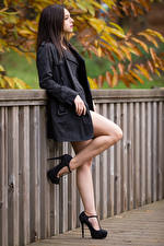 Pictures Brown haired Fence Posing Legs High heels Cape Tamy young woman