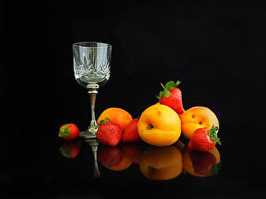 Picture Apricot Strawberry Black background Stemware Food
