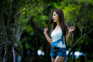 Image Asian Bokeh Hands Shorts Brown haired young woman