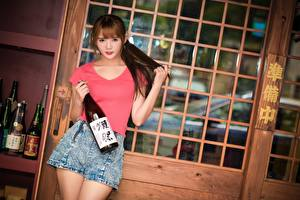 Pictures Asian Brown haired Glance Hands Shorts Bottle Pose Girls