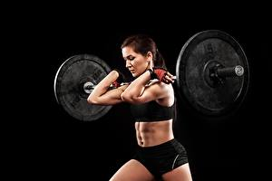 Pictures Barbell Workout Hands Belly Black background sports Girls