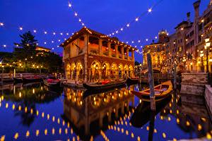 Picture Disneyland Building Boats Japan Tokyo Water Night time Fairy lights Reflected Urayasu Cities