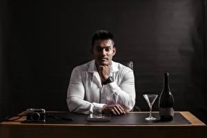 Images Indian Men Formal shirt Staring Hands Sitting Camera Bottle Stemware