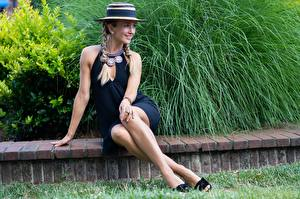 Pictures Jewelry Sit Dress Legs Plait Hat Smile young woman