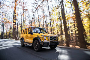 Pictures Mercedes-Benz G-Class Roads Motion Yellow SUV g63 AMG