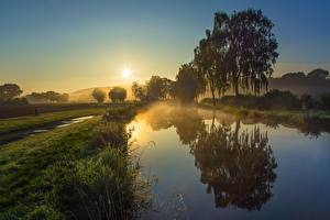 Images Morning Sunrises and sunsets Canal Sun Grass Trees Fog Reflection