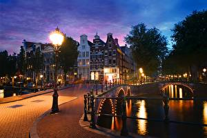 Pictures Netherlands Amsterdam Bridges Houses Evening Canal Street lights Keizersgracht Cities