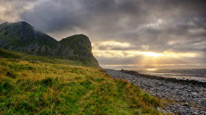 Images Norway Lofoten Coast Mountain Sunrise and sunset Clouds Unstad Beach Nature
