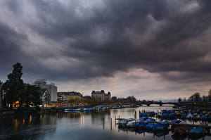 Images Switzerland Zurich Building River Bridge Berth Boats Clouds Storm cloud