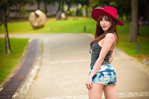 Wallpapers Asiatic Blurred background Hat Staring Hands Shorts Posing young woman