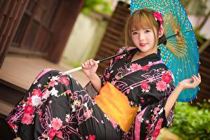 Photo Asian Parasol Brown haired Glance Sitting Kimono Hands