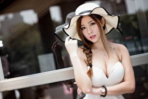 Picture Asian Watch Brown haired Hat Glance Hands Decollete Blurred background Plait Beautiful