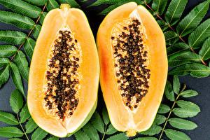 Bakgrundsbilder på skrivbordet Närbild Lövverk En bit Två 2 papaya Mat