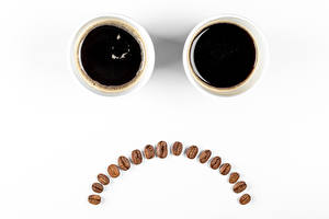 Photo Coffee Smilies White background Cup Two Grain Sadness