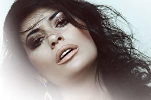 Desktop wallpapers Face Brunette girl Glance Makeup Hair young woman