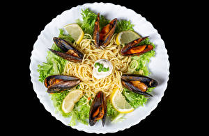 Photo Seafoods Vegetables Lemons Black background Plate Pasta mussels Food