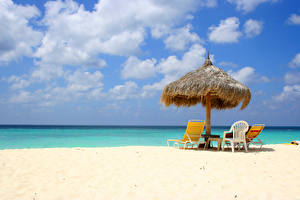 Pictures Sky Sea Parasol Sunlounger Clouds Beaches
