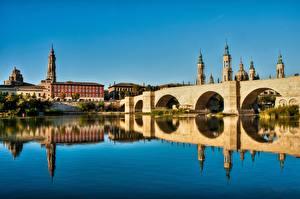 Bilder Spanien Flusse Brücke Kathedrale Spiegelung Spiegelbild Turm Zaragoza, river Ebro Städte