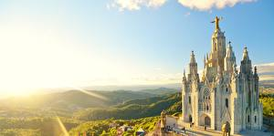 Image Sunrise and sunset Church Spain Rays of light Hill Barcelona mount Tibidabo, Temple of the sacred Heart of Jesus Cities