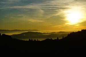 Images Switzerland Sunrises and sunsets Sky Hill Fog Silhouettes Basel-Landschaft Nature